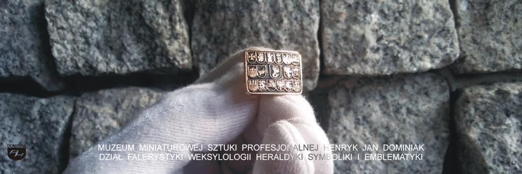 Heraldyka analizuje materiał modelowania herbów HER5 – HERBY MIAST - SPINKA DO MANKIETU KOSZULI 1972