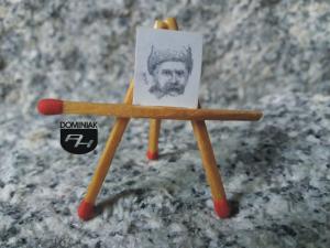 RYS61 KOZAK portret mężczyzny z wąsami w czapce na głowie Kozak rysunek ołówkiem 1,25 cm x 1,51 cm autor Volodymyr Goncharenko 2014